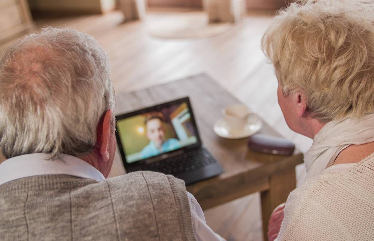 Older couple video chatting.