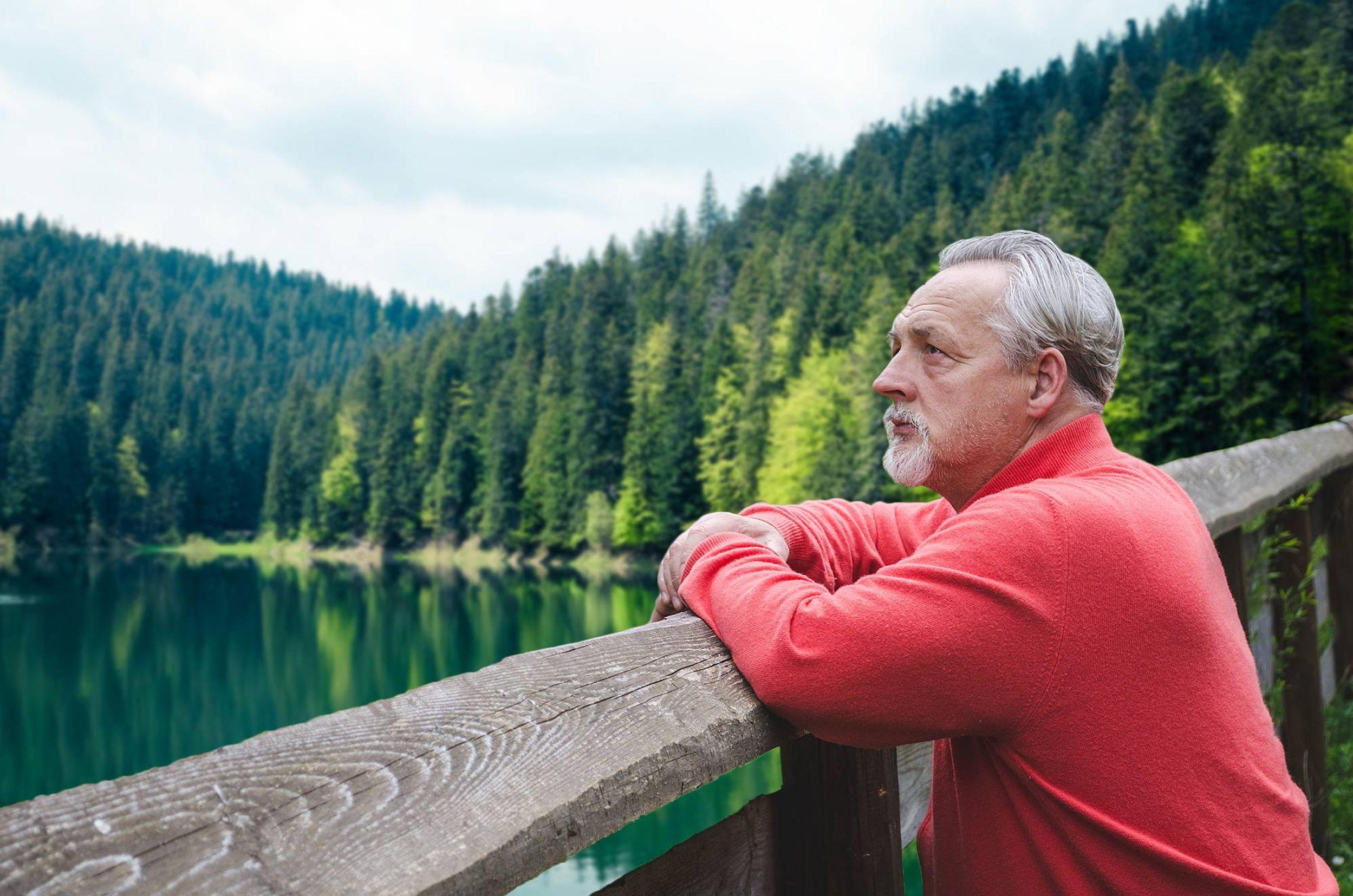 man in nature, looking pensive