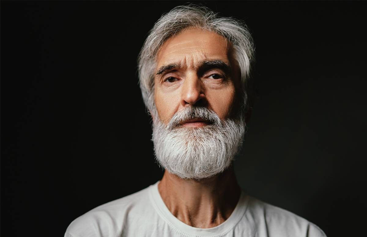 Portrait shot of man looking directly into camera.