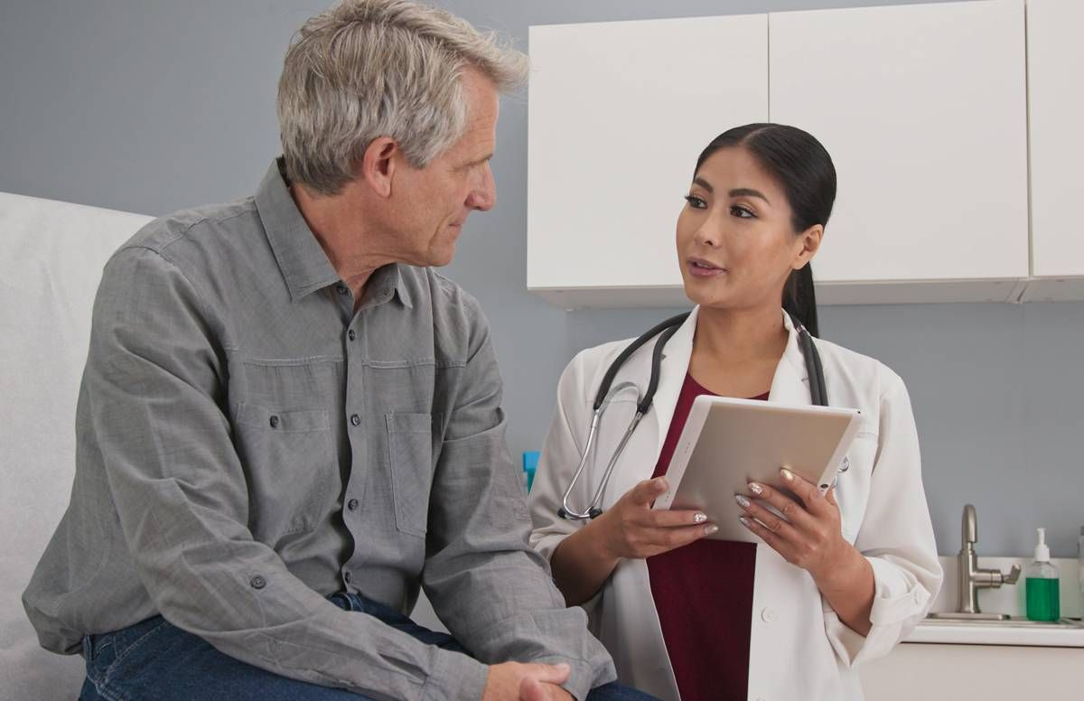 Patient conversing with primary care doctor.