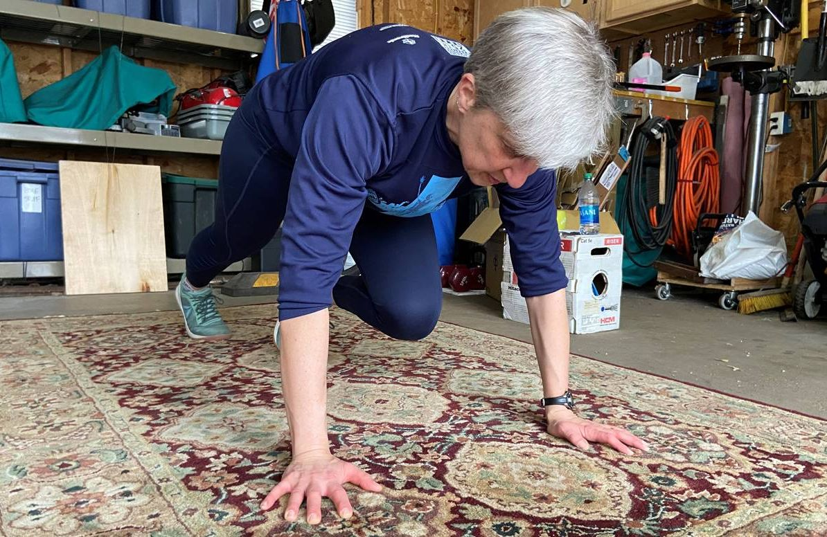 Erika Nelson often moves her car our of her St. Paul, Minn., garage to practice yoga and do exercises