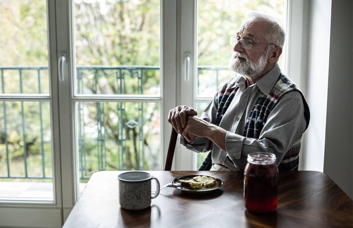 Man alone in kitchen