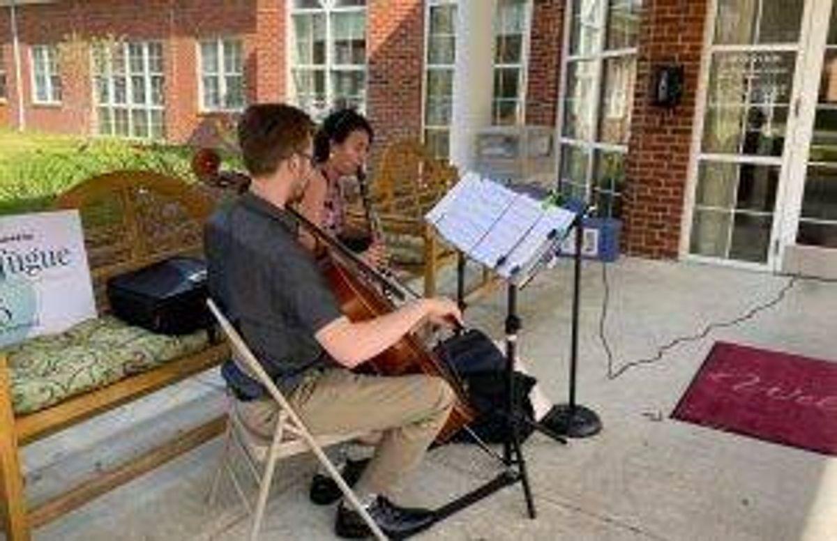 Tidewater Arts musicians play outside a senior facility in Chesapeake, Va.