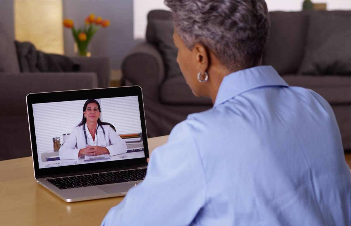 Patient virtually connecting with doctor.