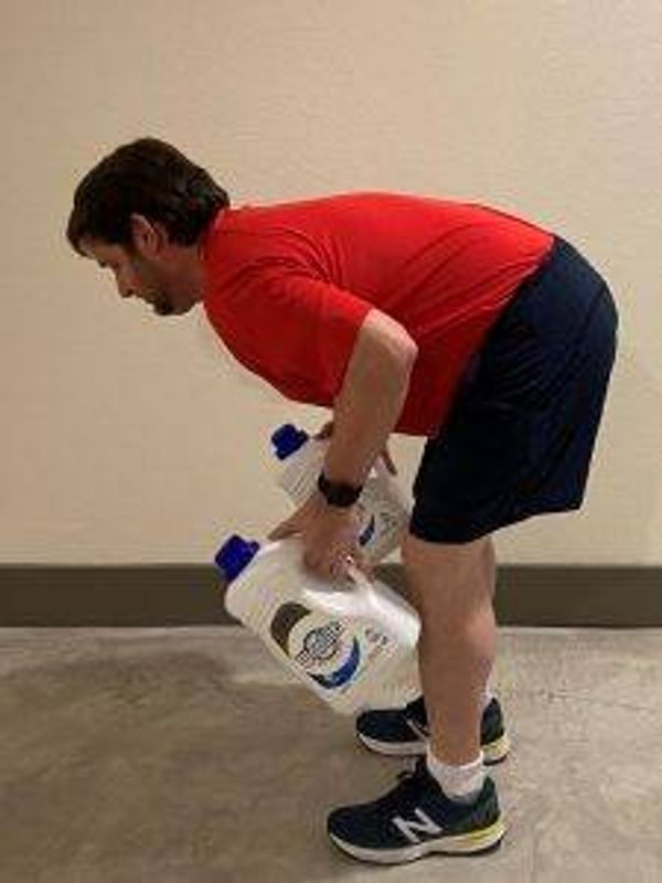 Tom Hippman, of Dallas, finds common household items to use for weight training