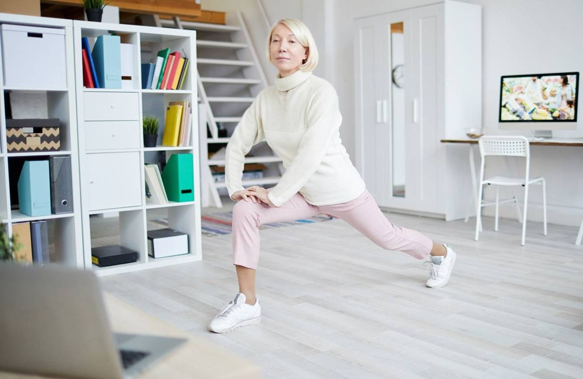 woman performing physical therapy exercises with virtual guidance
