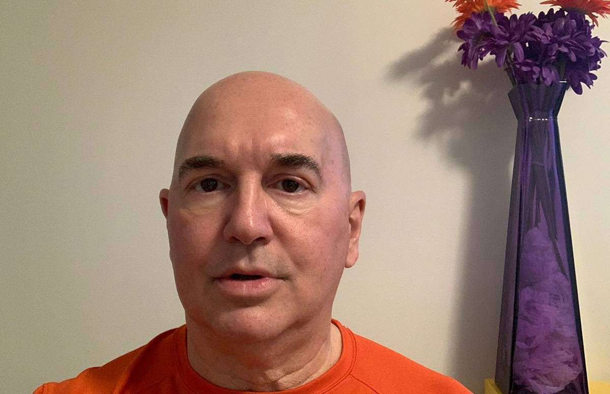 photo of essay author John-Manuel Andriote