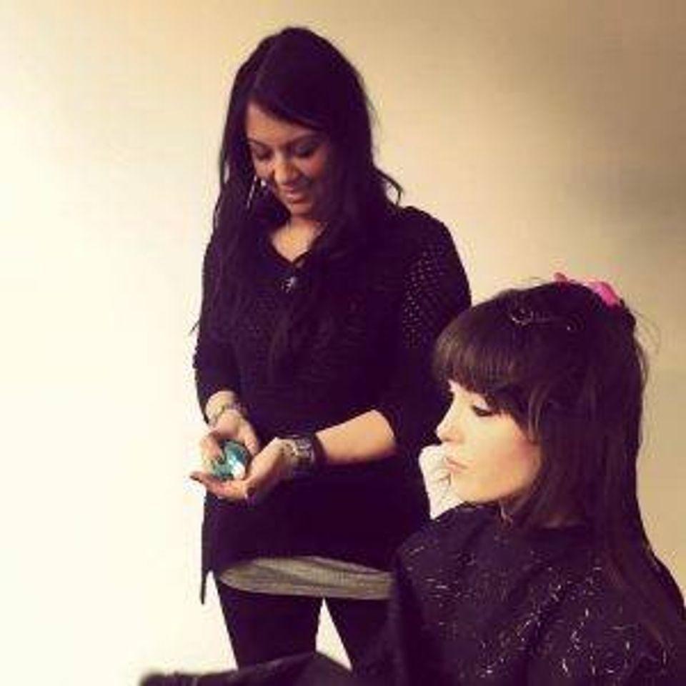 Stylist Kristine Murillo with a client, pre-COVID