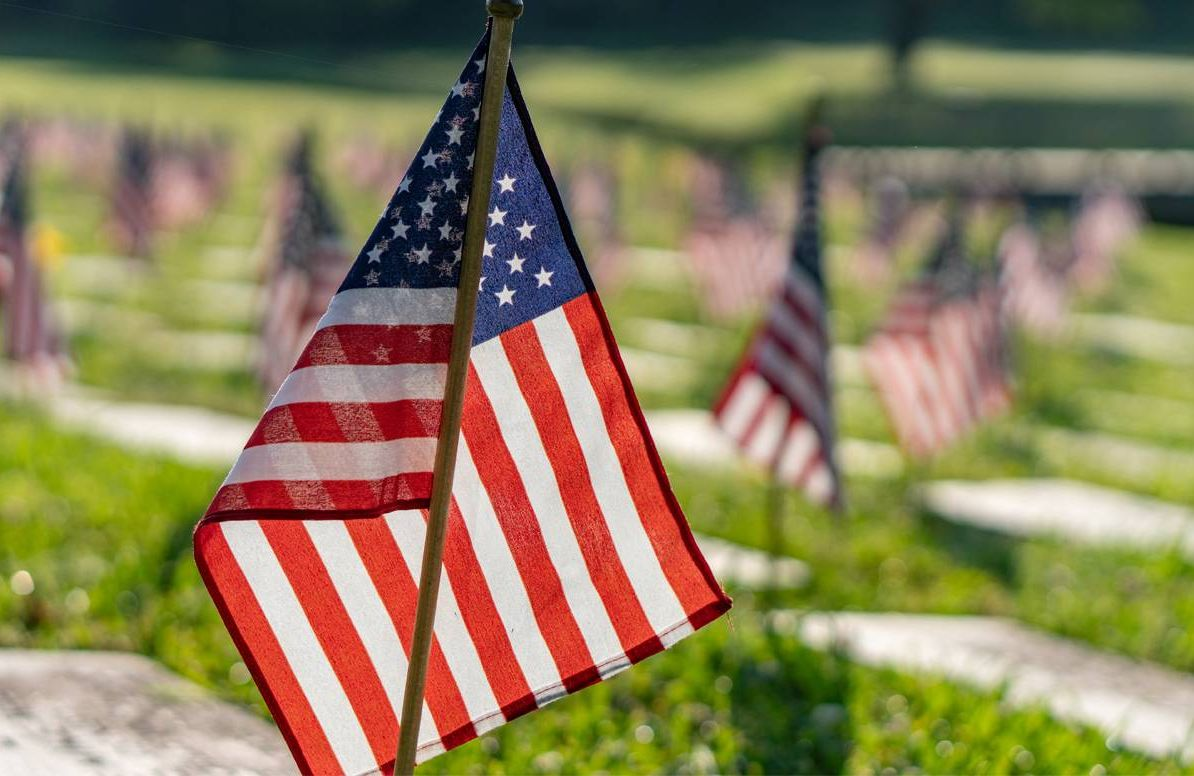 cemetery decorated with flags