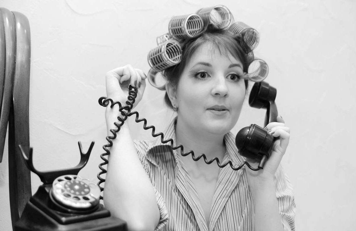woman in curlers on phone