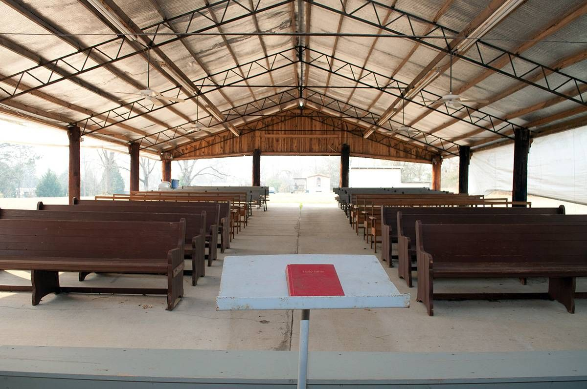 empty pews at outdoor church service