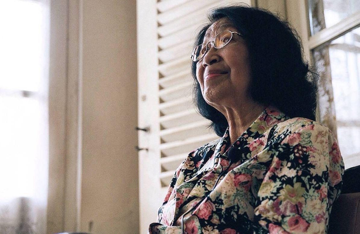 mature asian woman sitting