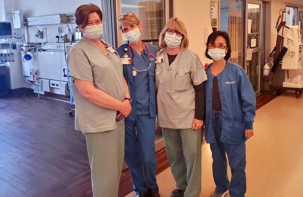 4 nurses with masks