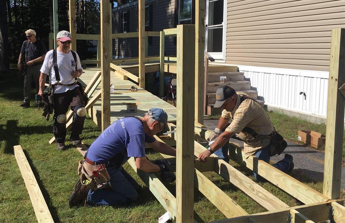 Volunteers building ramp