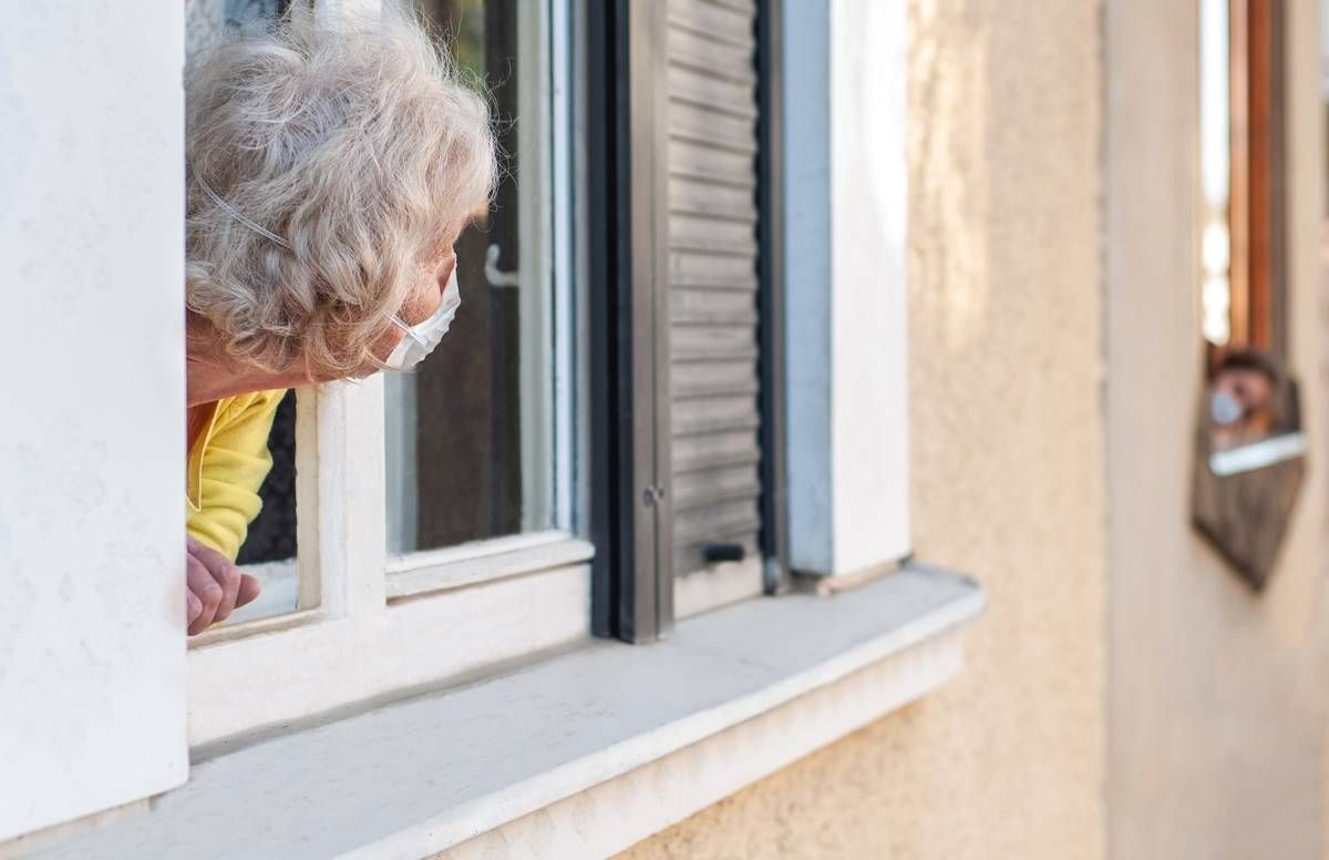 older person leaning out of window