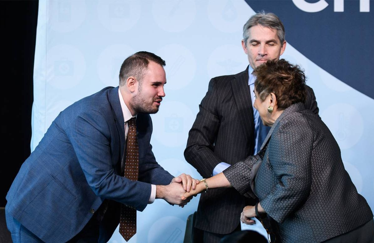 Jason Resendez shaking hands with Congresswoman Donna Shalala (D-FL)