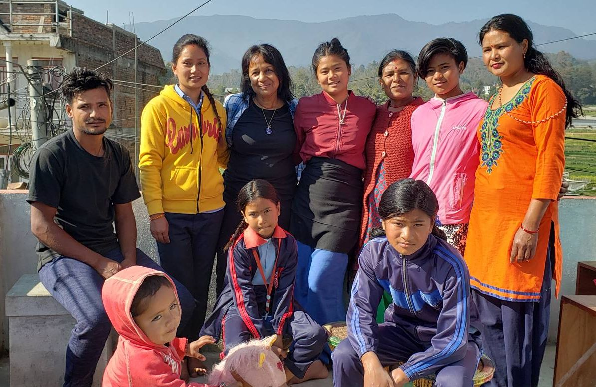 Kamana Mathur, center, with her host family in Panauti, Nepal