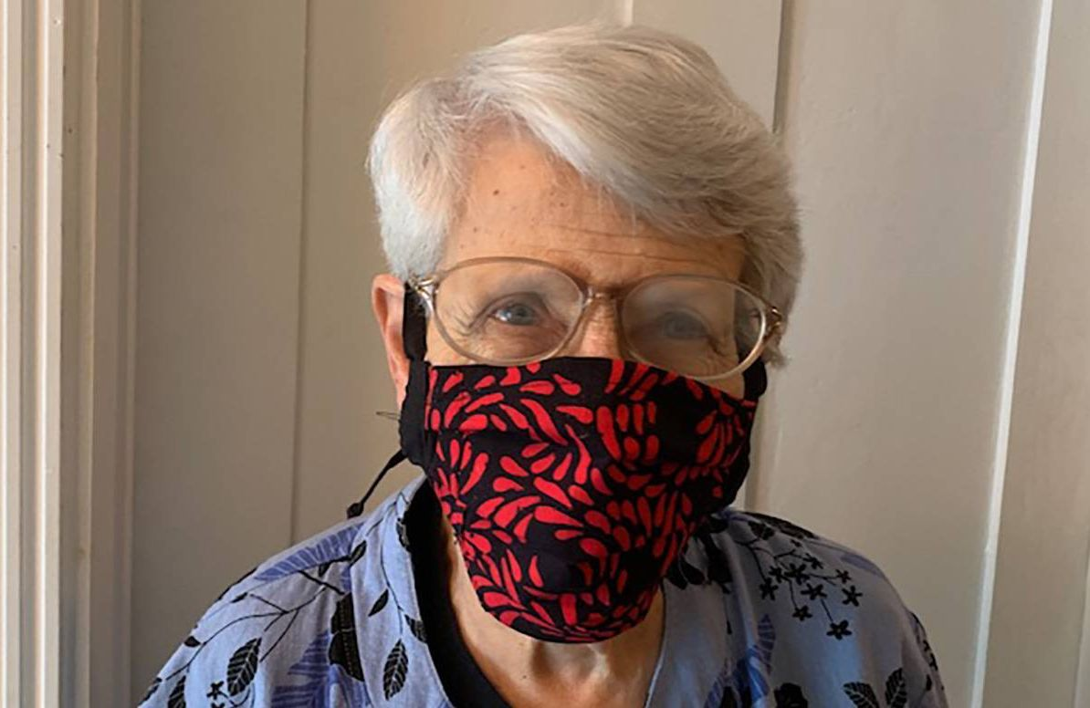 older person with COVID-19 mask