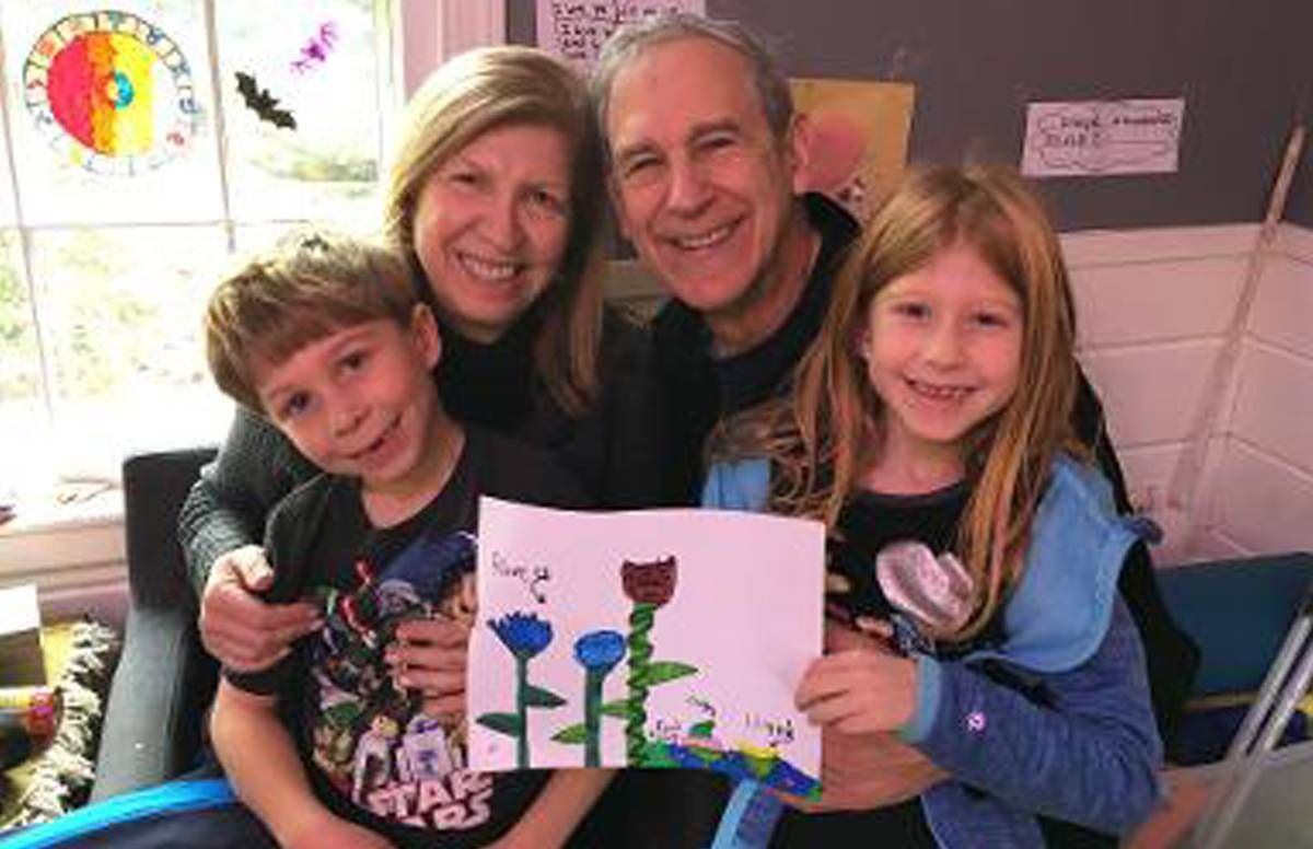 Wendy and her husband Ken (before the pandemic) with their two oldest grandchildren