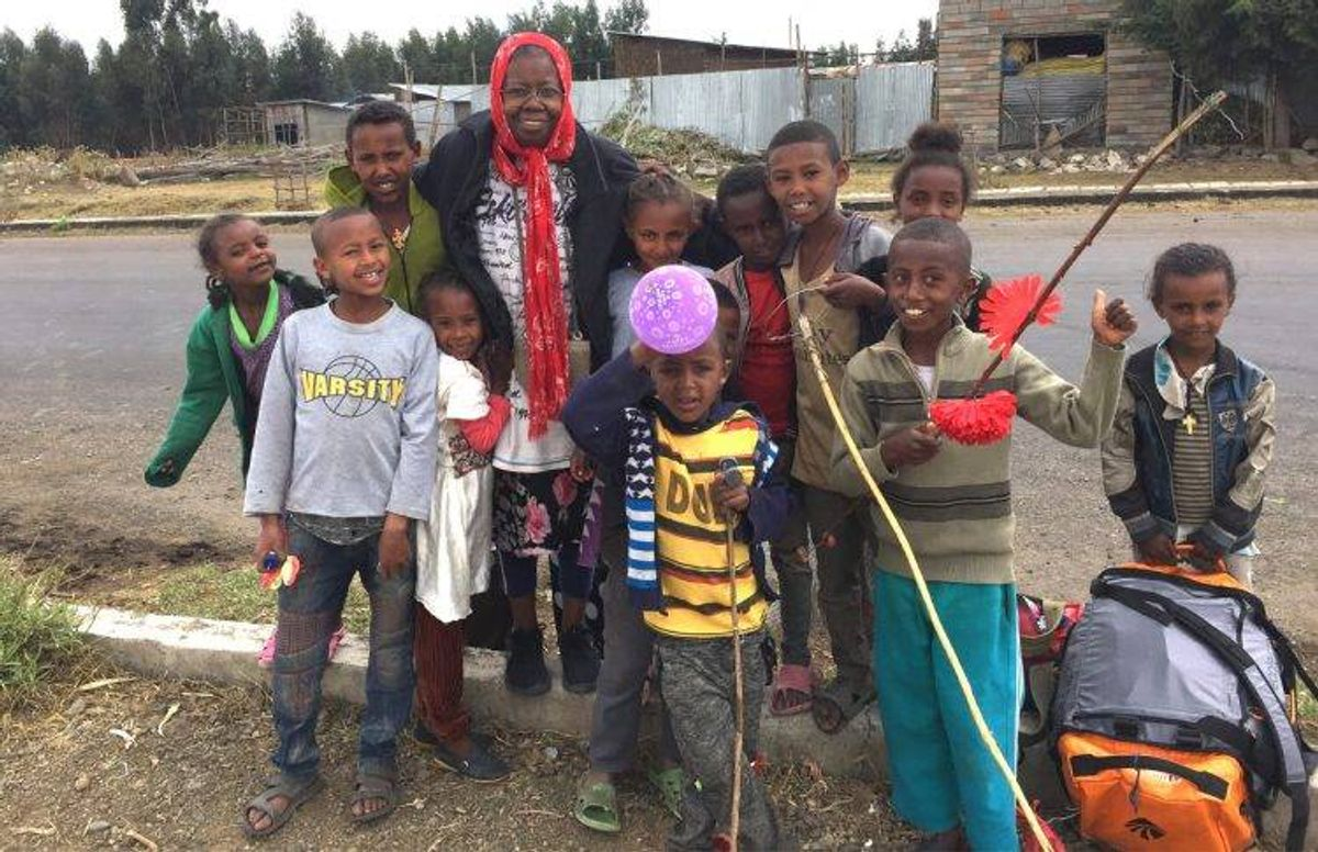 Karen Jean Hunt gathers with some of her students in Kotu, Ethiopia