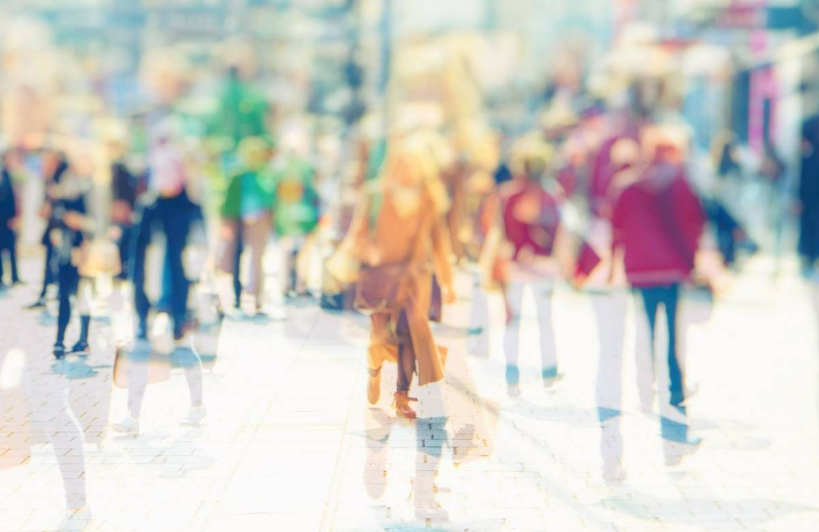 blurred, futuristic, abstract shot of people going about their lives