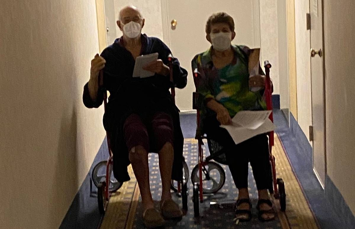 The author's parents in the hallway of their apartment building