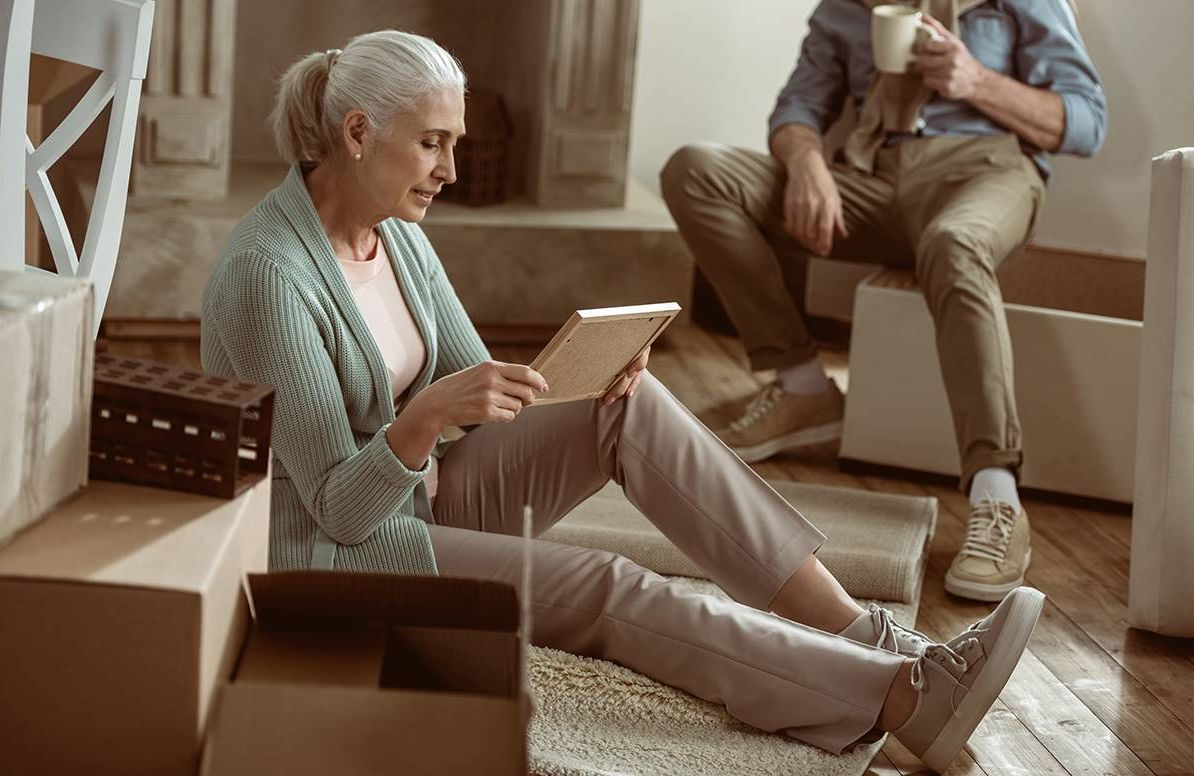 Woman looking at boxes