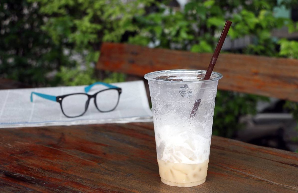 latte and a pair of glasses on a table