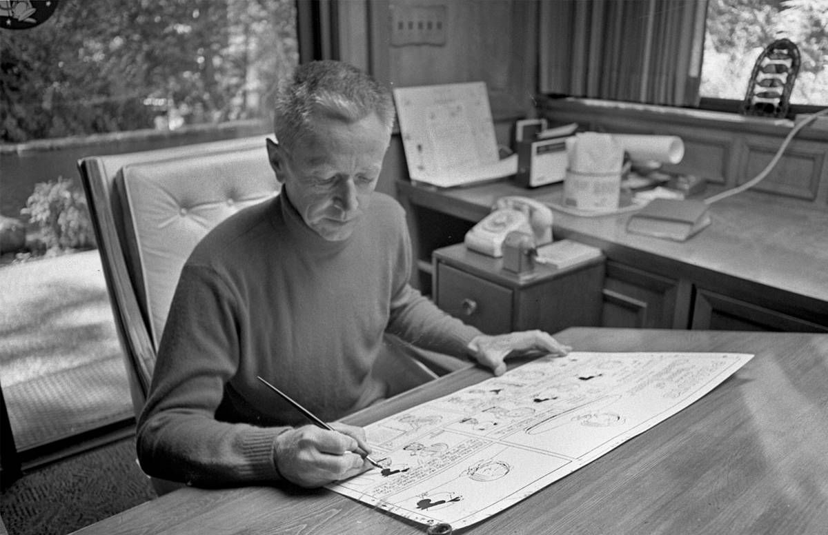Charles M. Schulz at his drafting table, 1969