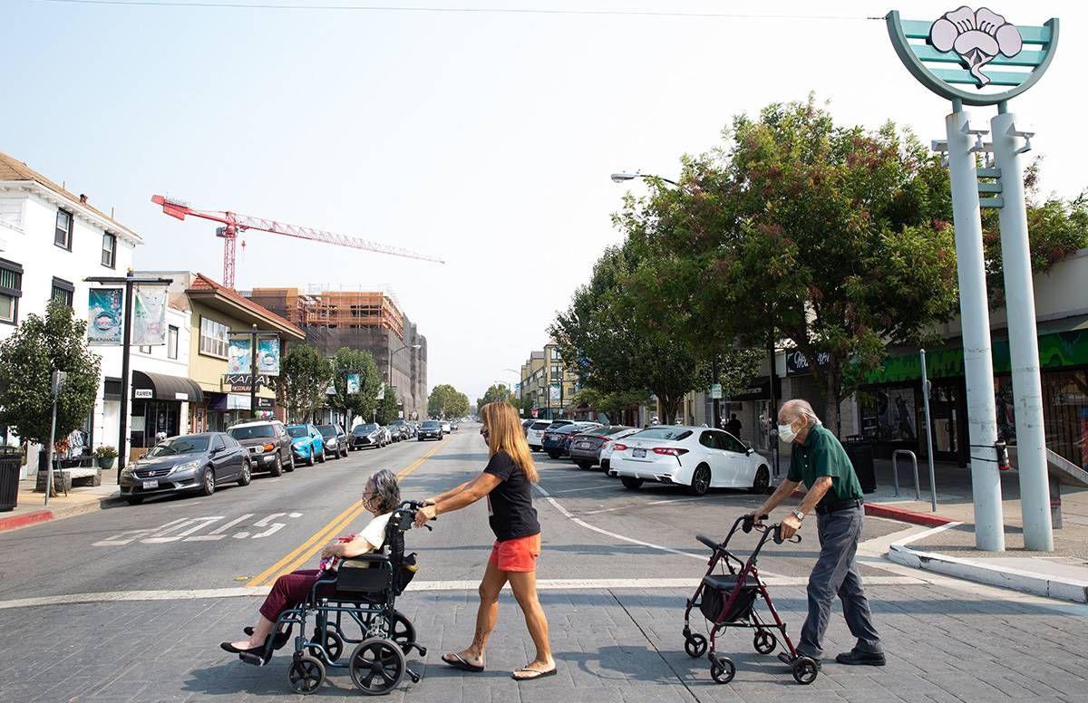 June Yasuhara crosses the street with her parents in San Jose's Japandown