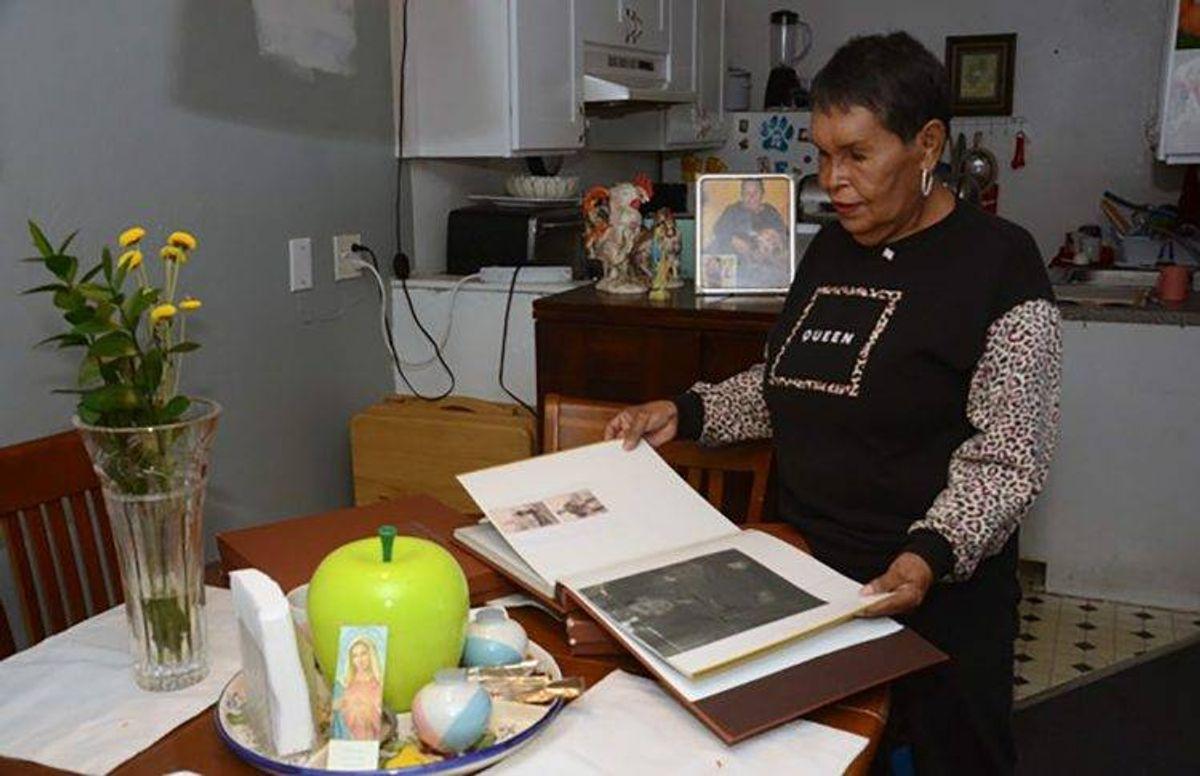 Felicia Elizondo looks through scrapbooks in her home