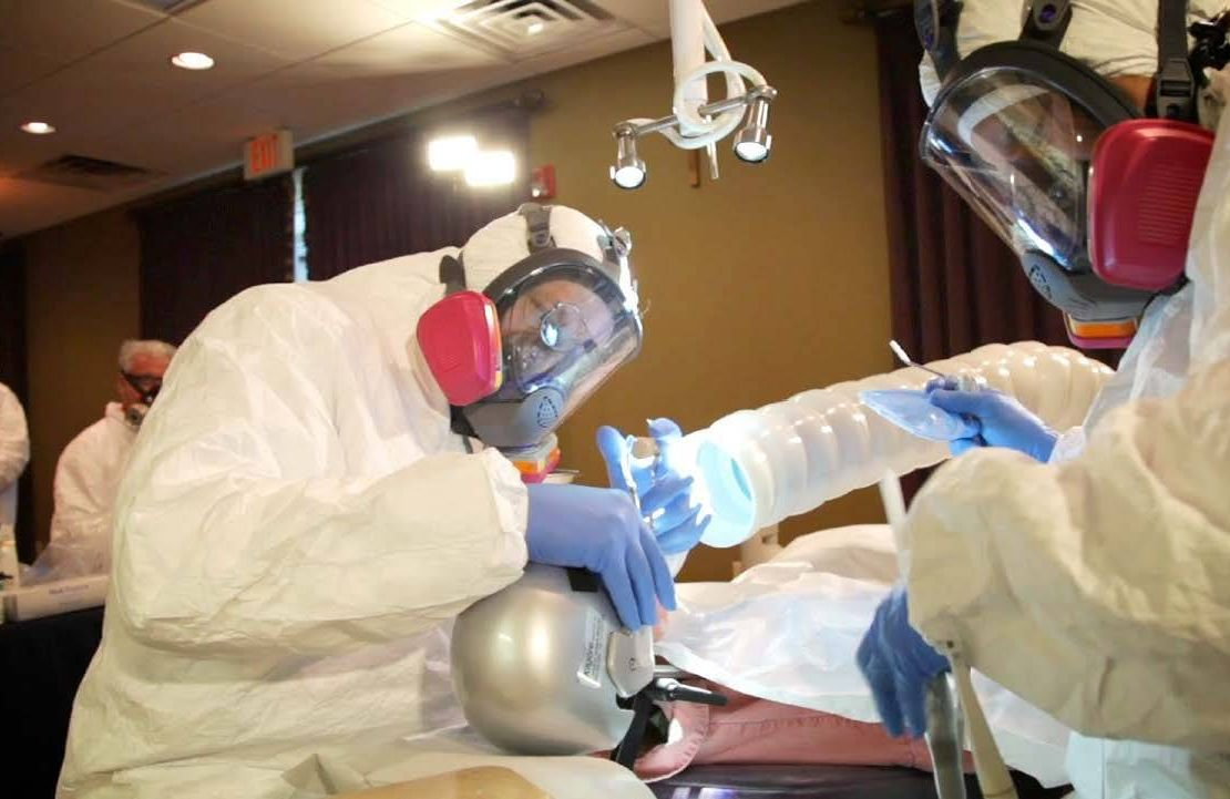 The dentists/dental staff wear a properly sealed mask rated to capture mercury or provide air/oxygen, a protective gown, face shield and hair net, and non-latex nitrile gloves, Next Avenue, dental hygiene