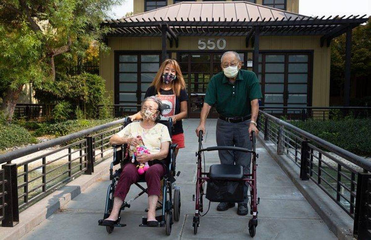 June Yasuhara and her parents James and Eiko Oka on their daily walk through San Jose's Japantown