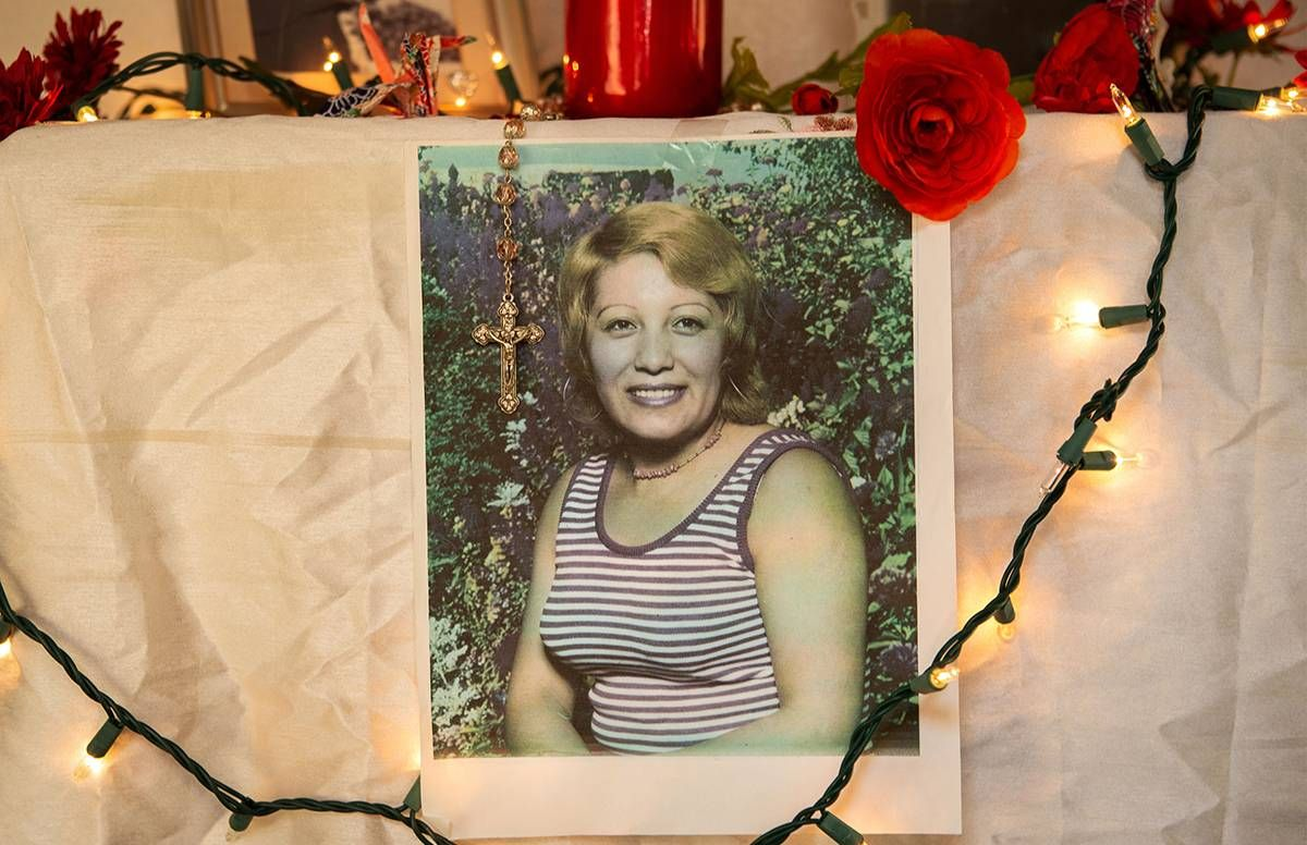 A photo of Maria Elena Nuñez displayed on an alter in her daughter's home