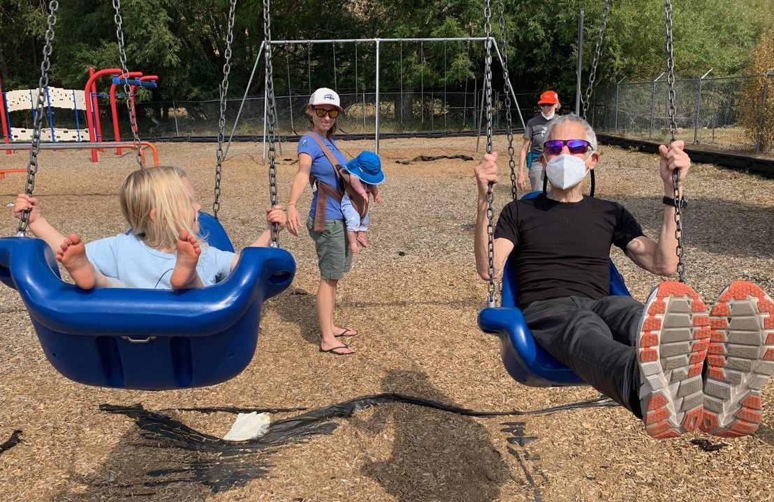 Marc and his granddaughter Jolene swinging, with daughter Maya and grandson Conrad in background. Photo by Daniela Silver, grandchildren, Next Avenue