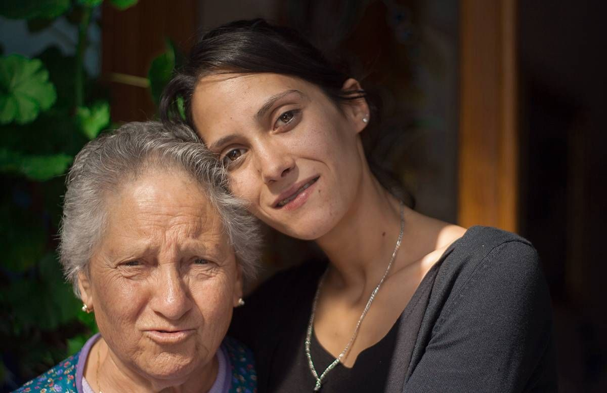 older latina woman and her daughter