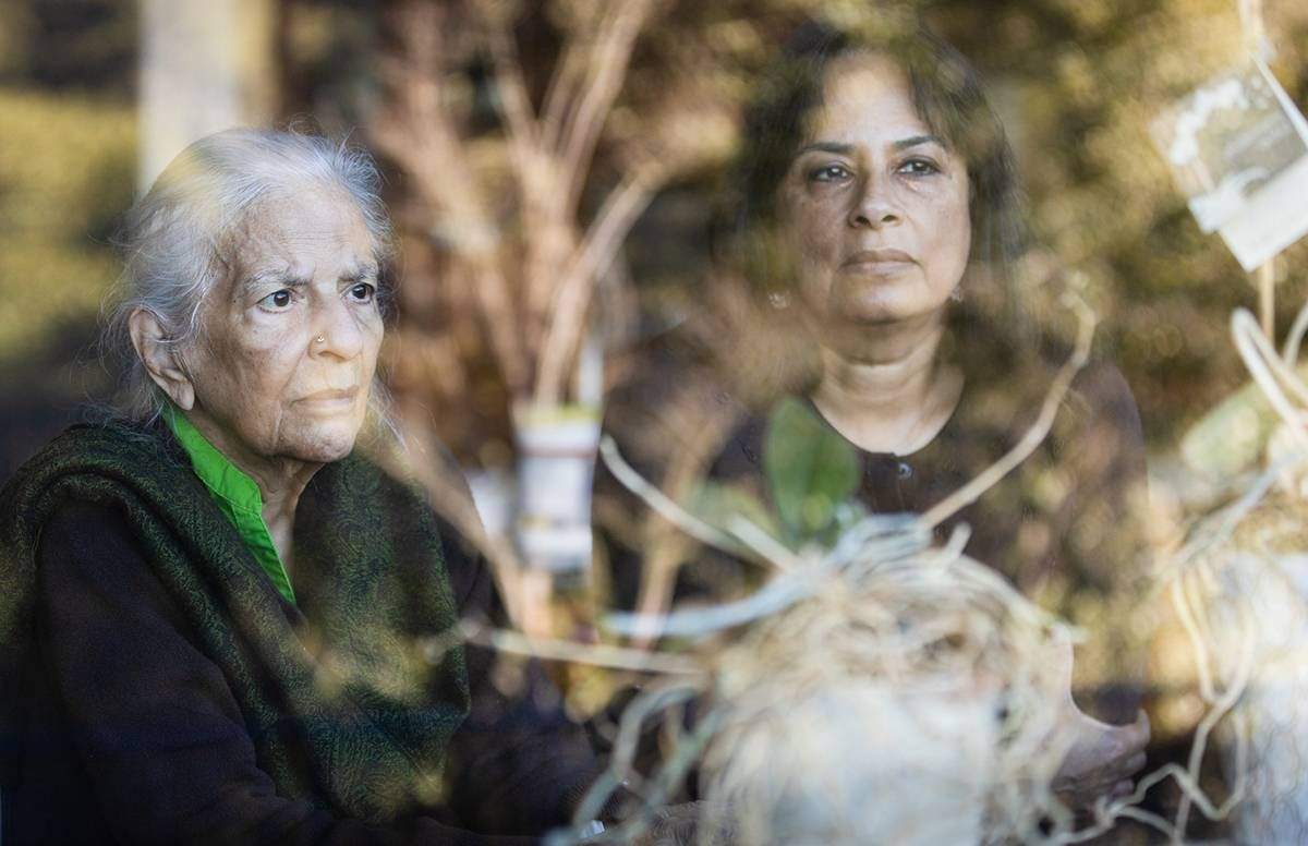 Jaya Padmanabhan (right), her mother, Sarada Ramachandran, and the orchids at their home in Los Altos Hills, CA, on Sunday, December 20, 2020.