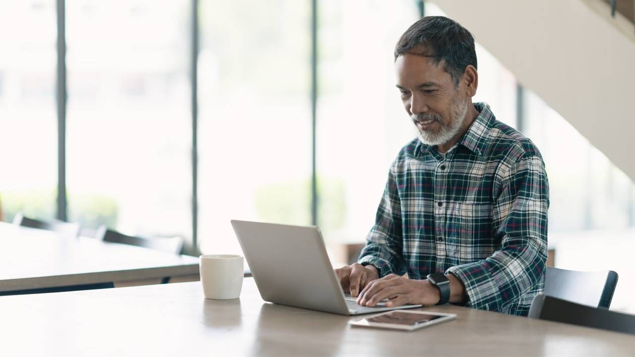 Man at computer, digital estate plan, Next Avenue