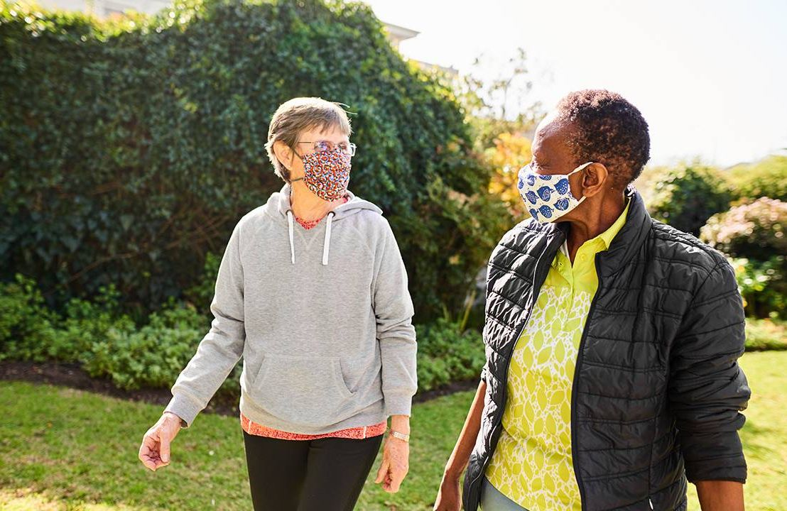 Two friends walking wearing face masks, friendship, Zoom fatigue, Next Avenue