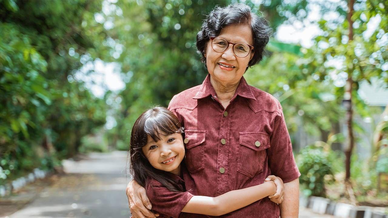 A grandma and her grandchild hugging, grandchildren
