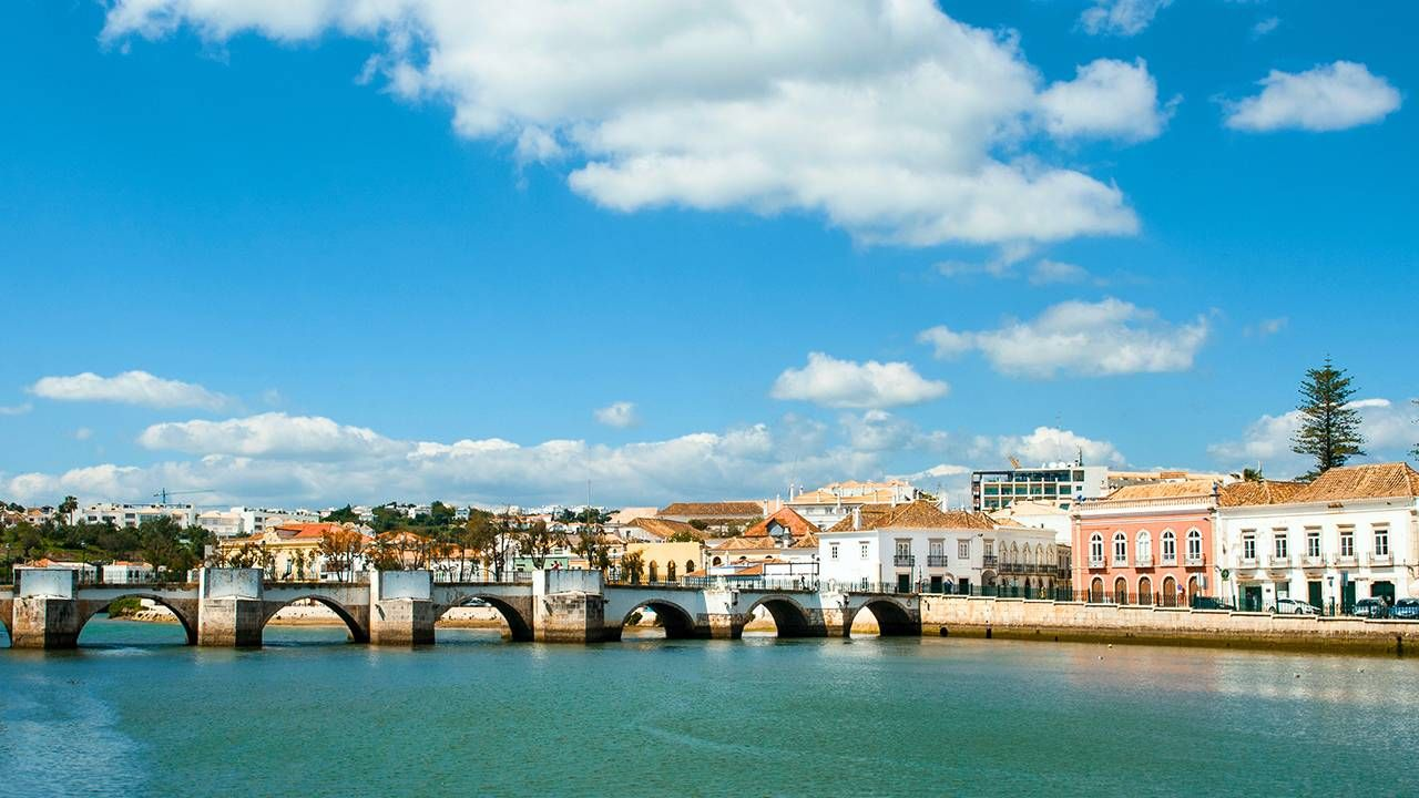 Bridge over water and buildings of Tavira, Portugal, retire abroad