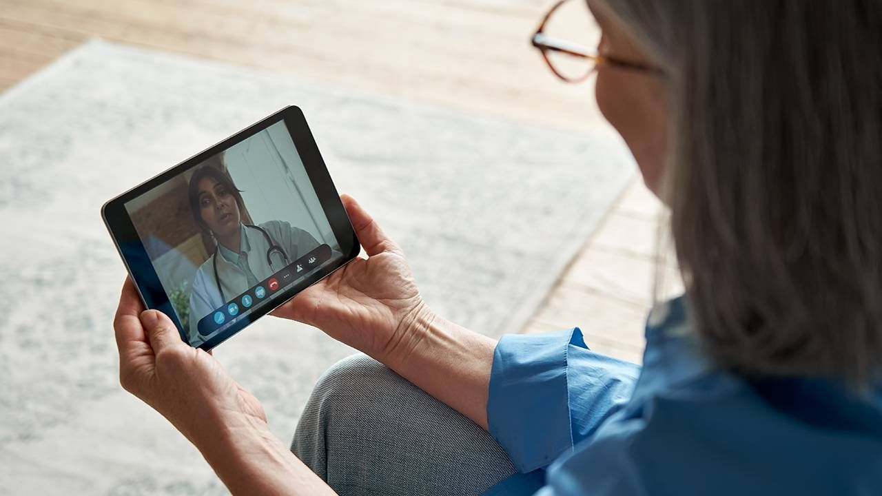 Older adult using Telehealth for a doctor appointment, technology and connecting