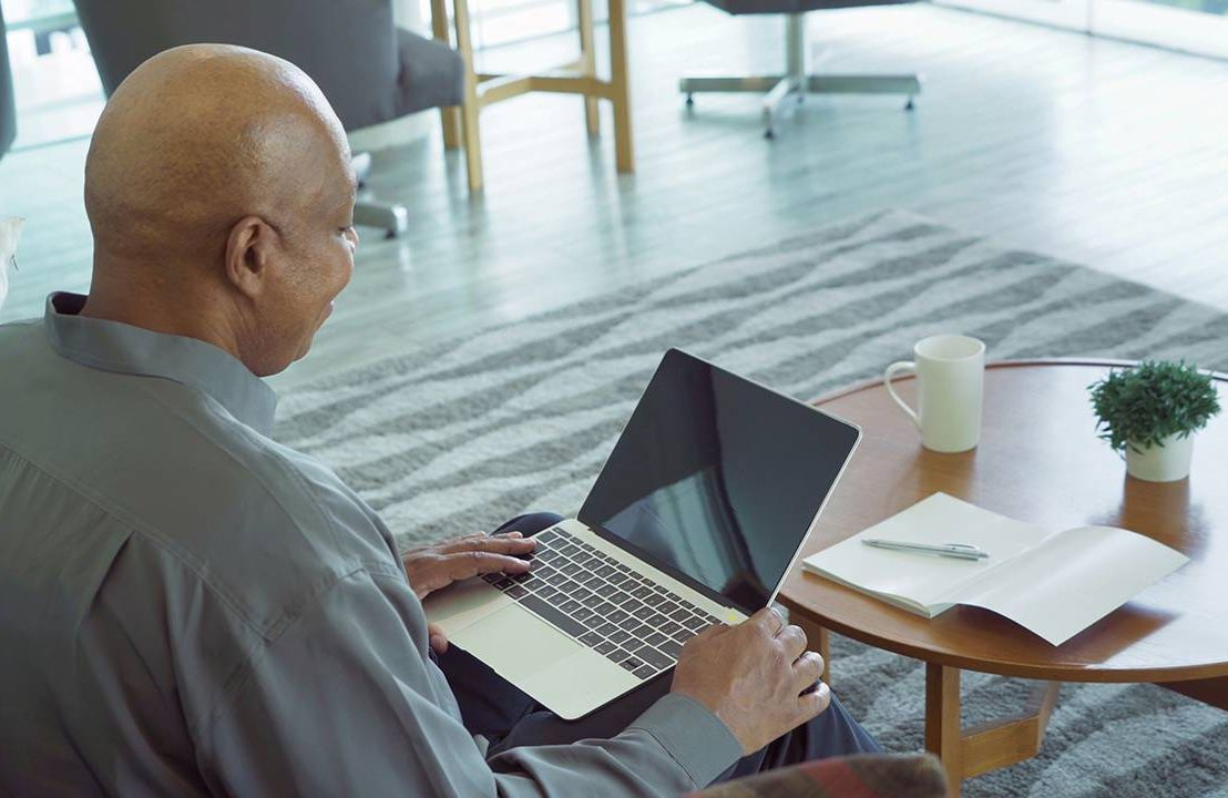 Man working from home, what older workers need on his laptop