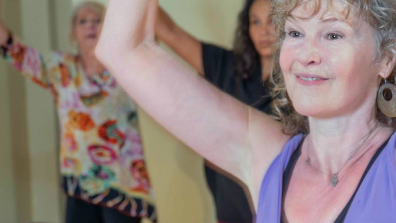 Woman dancing during a Nia class, pelvic pain, health and fitness, Next Avenue