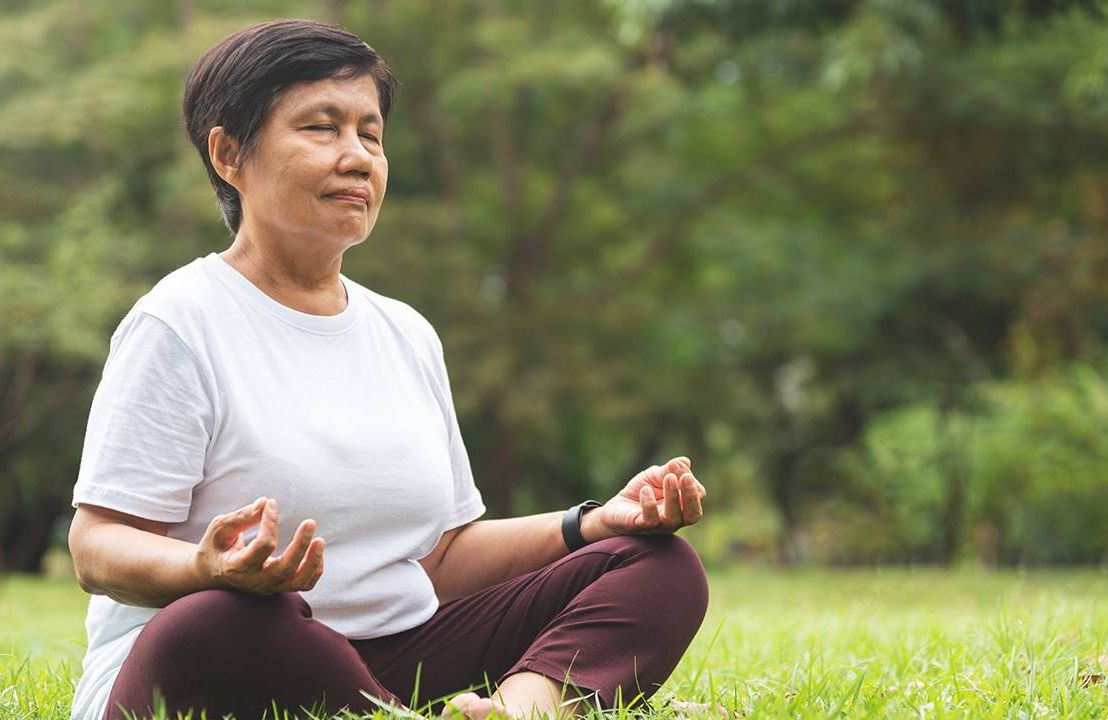 Older woman practicing yoga, treat your body kindly