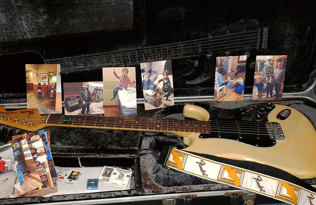 Fender electric guitar and photos of grandchildren, music, Next Avenue