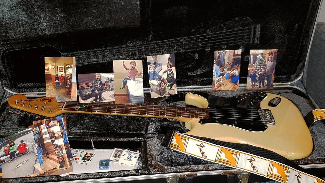 Fender electric guitar and photos of grandchildren, music, Next Avenue