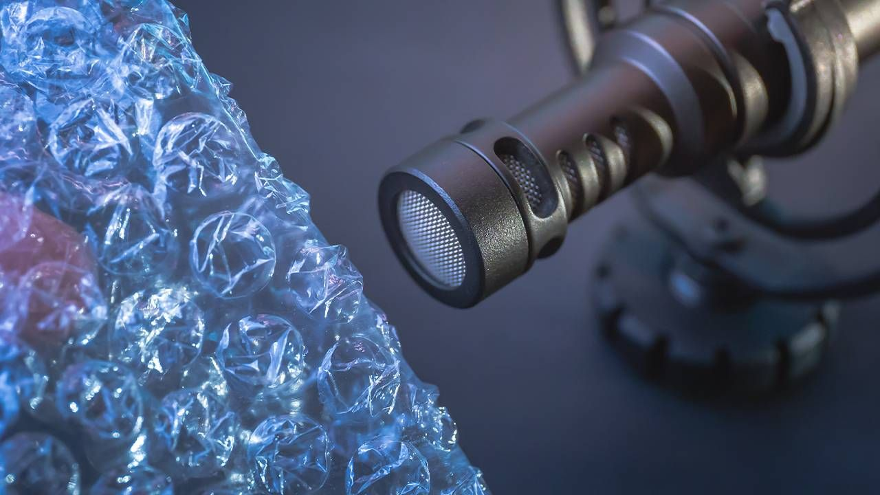 ASMR sounds, bubble wrap popping into a microphone