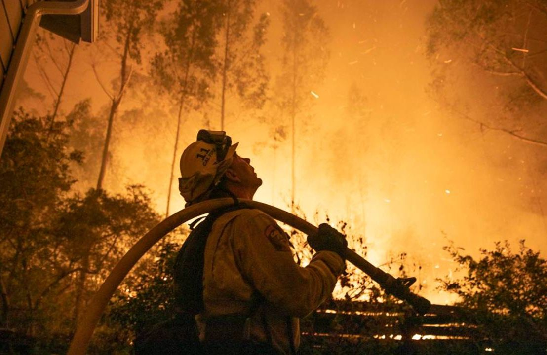 Firefighter fighting wildfire, natural disasters