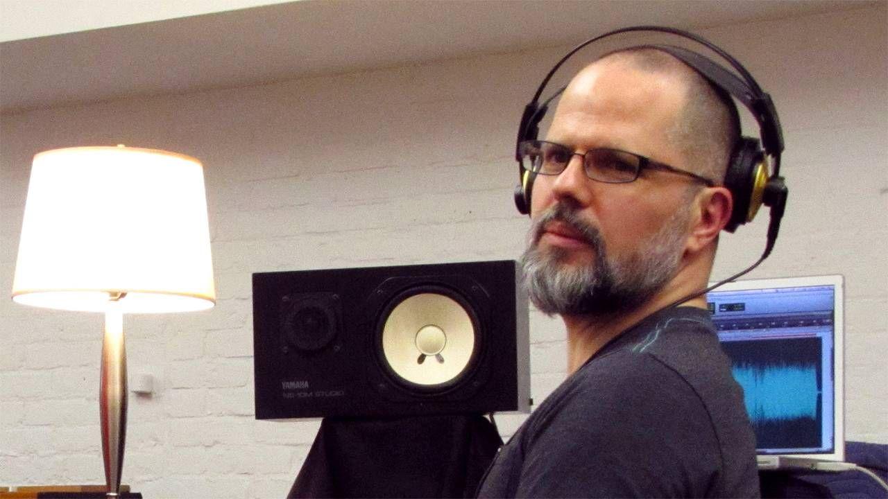 man wearing headphones working on computer, home business, entrepreneur, Next Avenue